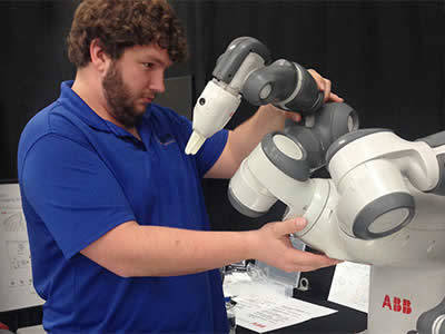 Ted Doyle interacts with QComp YuMi collaborative Robot
