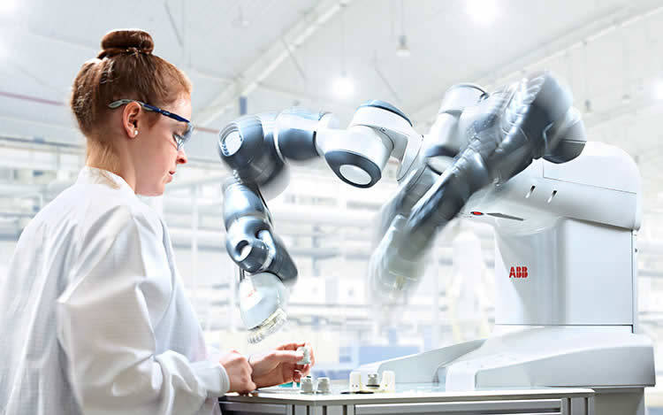 photo of woman operating a QComp ABB YuMi Laboratory Robot